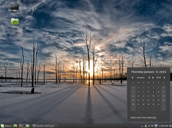 The Cinnamon desktop on Linux Mint 16 Cinnamon edition showing the panel calendar. By the way, that is not the default wallpaper.