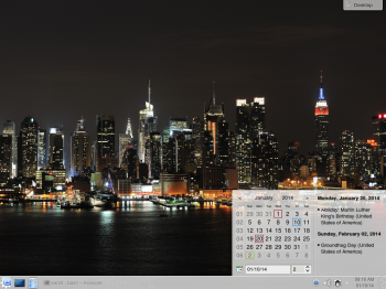 The default desktop of Linux Mint 16 KDE showing the panel calendar. That is not the default wallpaper.